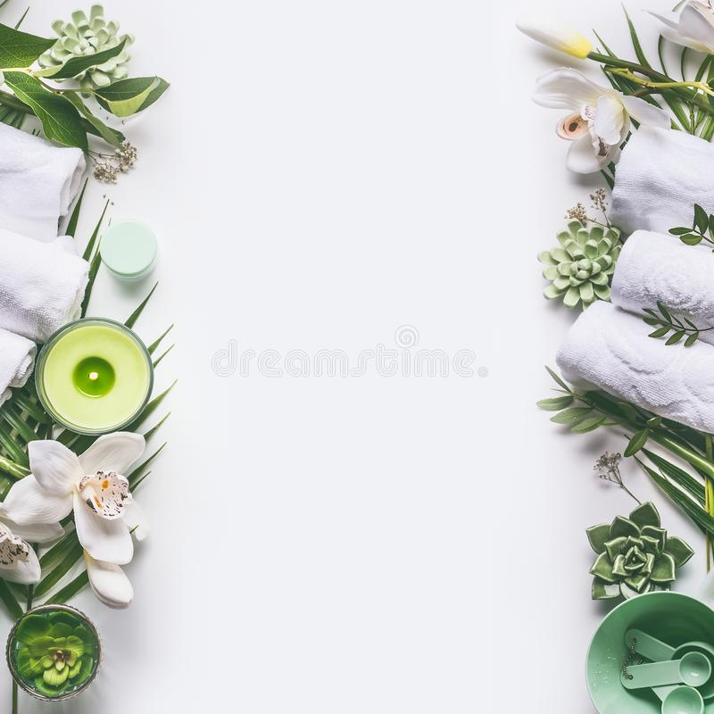 Free Green Spa Or Wellness Layout Frame With Towels, Candle, Tropical Leaves , Orchid Flowers, Succulents And Body And Face Care Tools Stock Images - 113926504