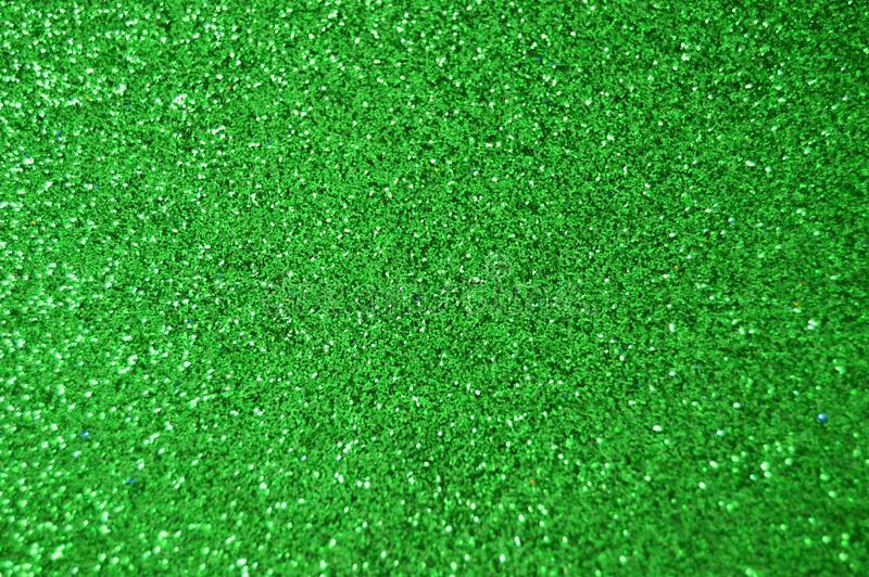 Green Sparkle Glitter background. Holiday, Christmas, Valentines, Beauty and Nails abstract texture. Green Sparkling Glitter background. Holiday, Christmas stock images