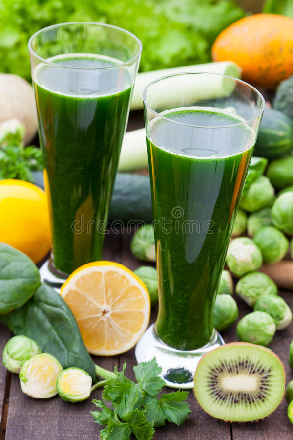 Green spinach smoothies. Green smoothies with different fruits and vegetables stock images