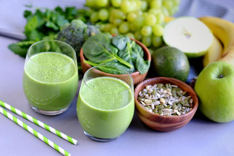 Green spinach smoothies with fruits, vegetables and seeds. Healthy food concept royalty free stock image