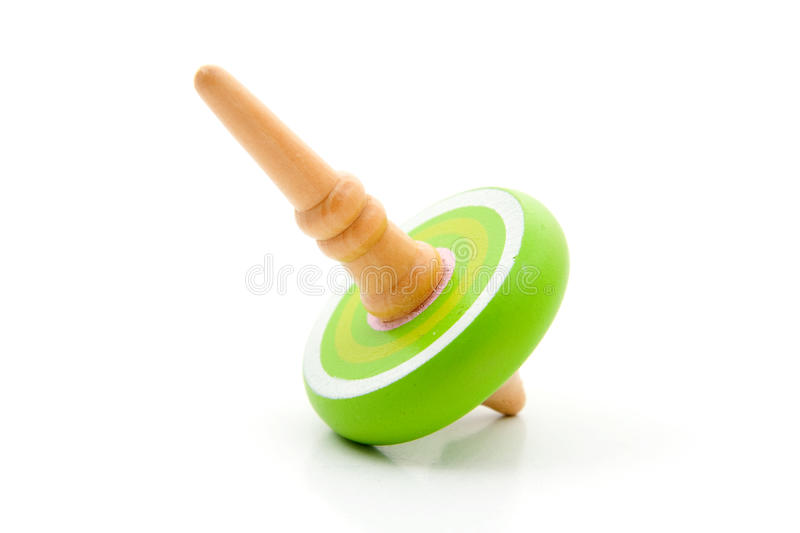 Green spinning top royalty free stock image