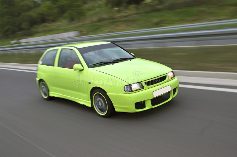 Green sport car drive fast royalty free stock photos