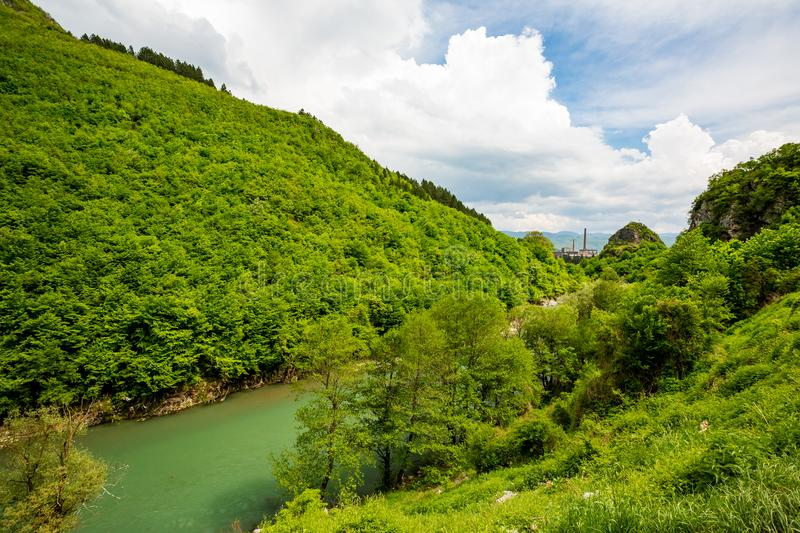 Green spring landscape, river and factory, Serbia stock photography