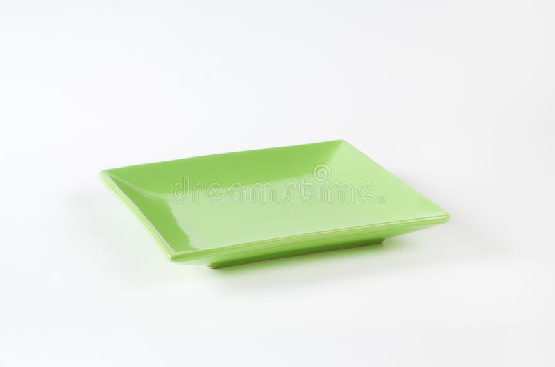 Green square plate. On white background stock photography
