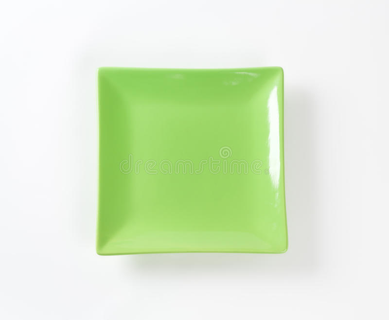 Green square plate. On white background royalty free stock photo