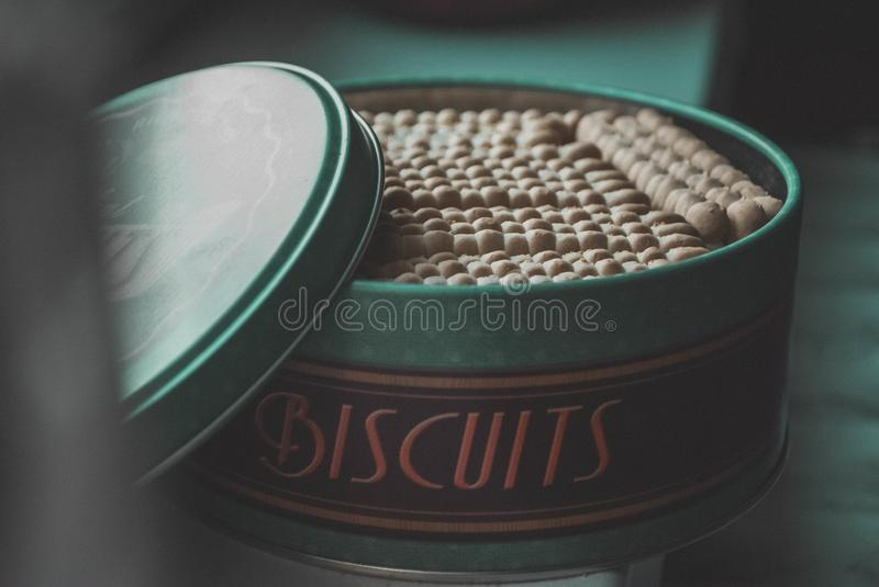Green Steel Container With Biscuits Lot royalty free stock photo