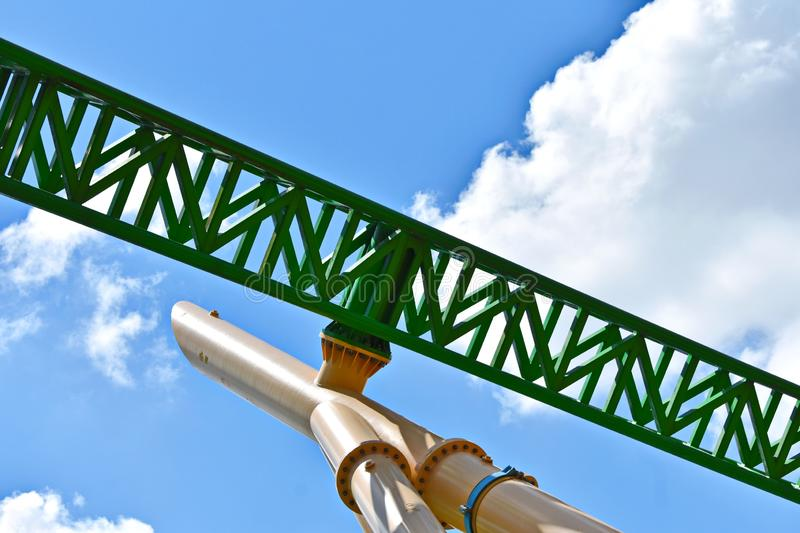 Green steel roller coaster ready to thrill riders on cloudy blue sky at Bush Gardens. Tampa, Florida; September 29,2018. Green steel roller coaster ready to royalty free stock photography