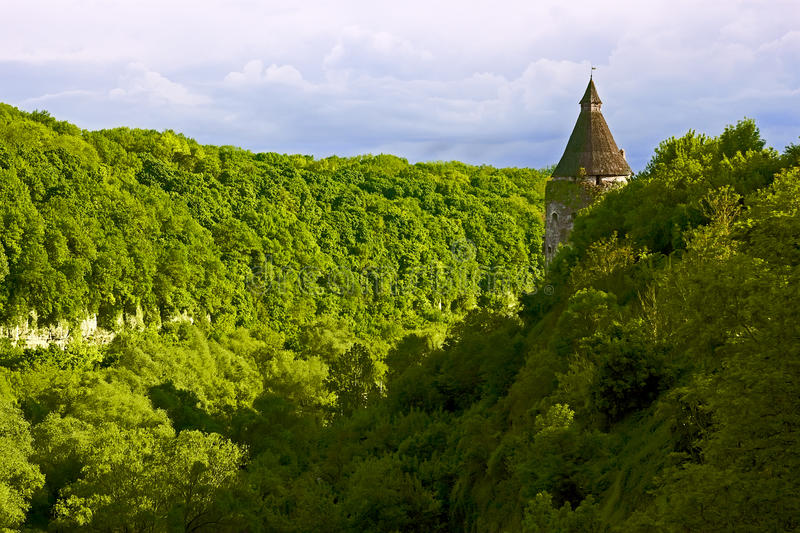 Green steep slope in Kamianets-Podilsky, Ukraine. Green steep slope near the Smotrych River in the city Kamianets-Podilsky, Ukraine. Medieval fortifications on royalty free stock image