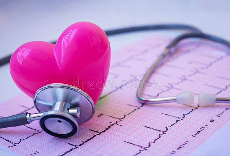 Green stethoscope and pink Heart. stock image
