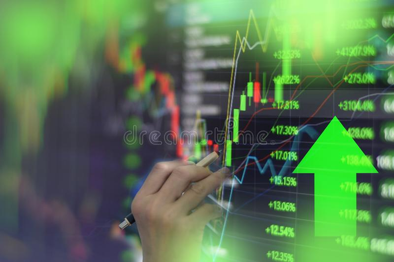 Green stock market graph chart with indicator investment trading stock exchange trading market monitor screen close up.  stock photo