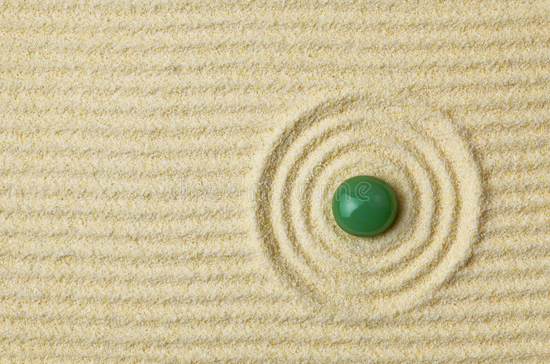 Download Green Stone On Surface Of Yellow Sand Stock Image - Image: 12194955