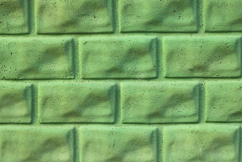 Green stone wall stock image