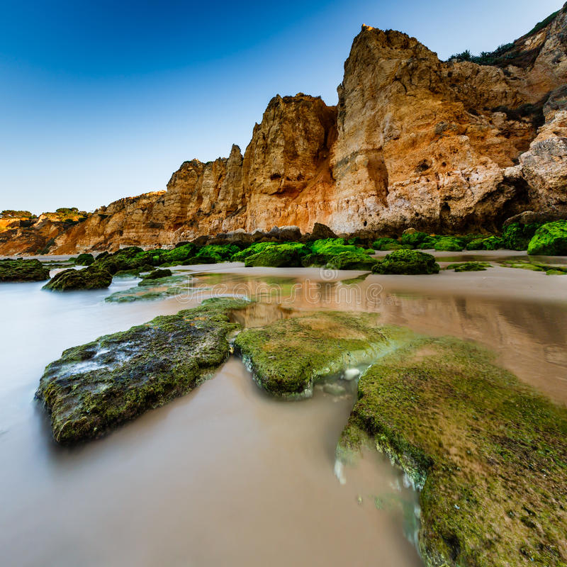 Download Green Stones At Porto De Mos Beach In Lagos, Algarve Stock Photo - Image: 33406066