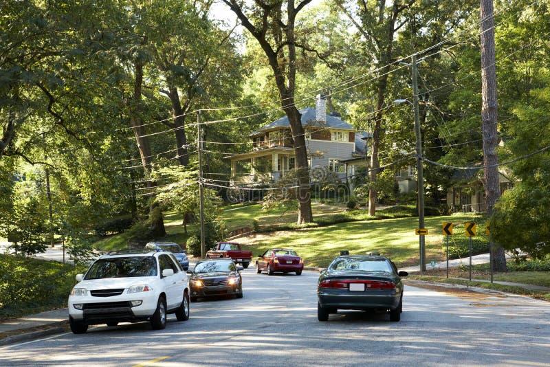 Green street. Houses and cars. Atlanta, GA. Green street. Houses in trees and cars on the road. Atlanta, GA stock image
