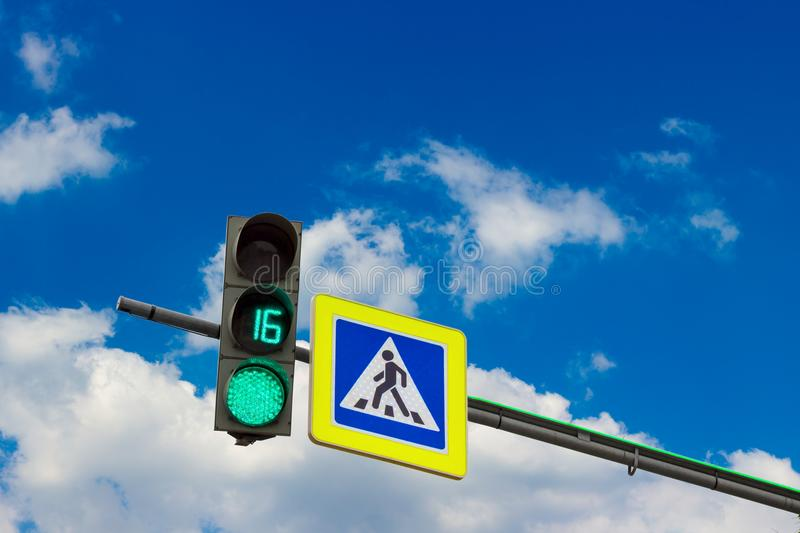 Green streetlight signal stock image
