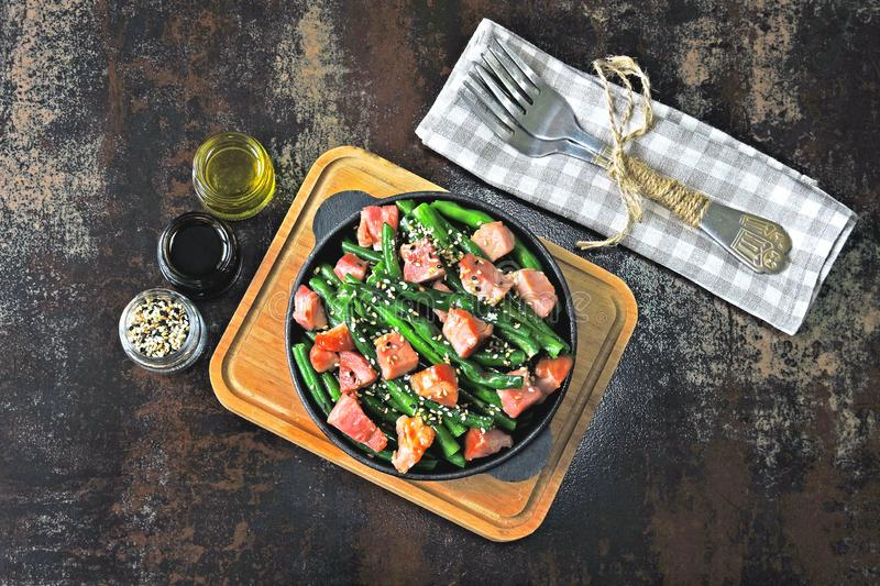 Green beans with bacon in a cast iron skillet. Healthy eating concept. Keto diet. Pegan diet. Paleo diet. stock image
