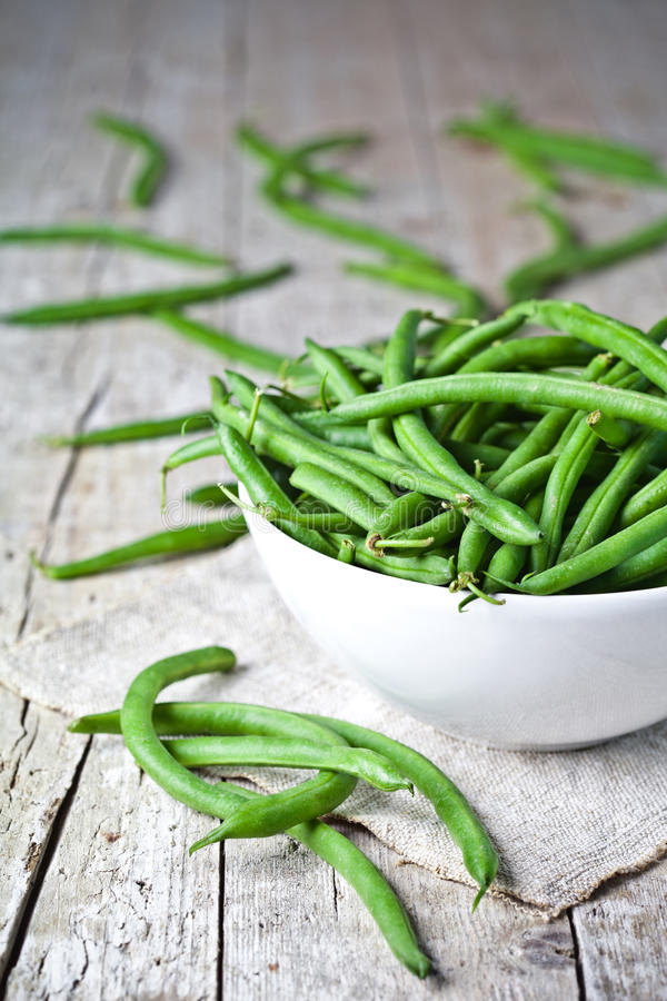 Green string beans in a bowl stock image