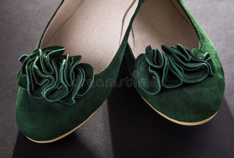 Green suede flats royalty free stock image