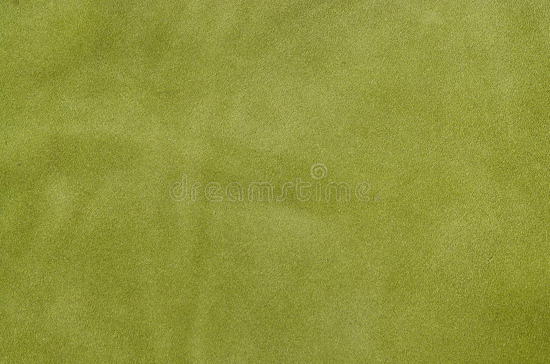 Green suede soft leather as texture background. Close up leather. Green suede soft leather as texture background. Close up shammy leather texture stock images