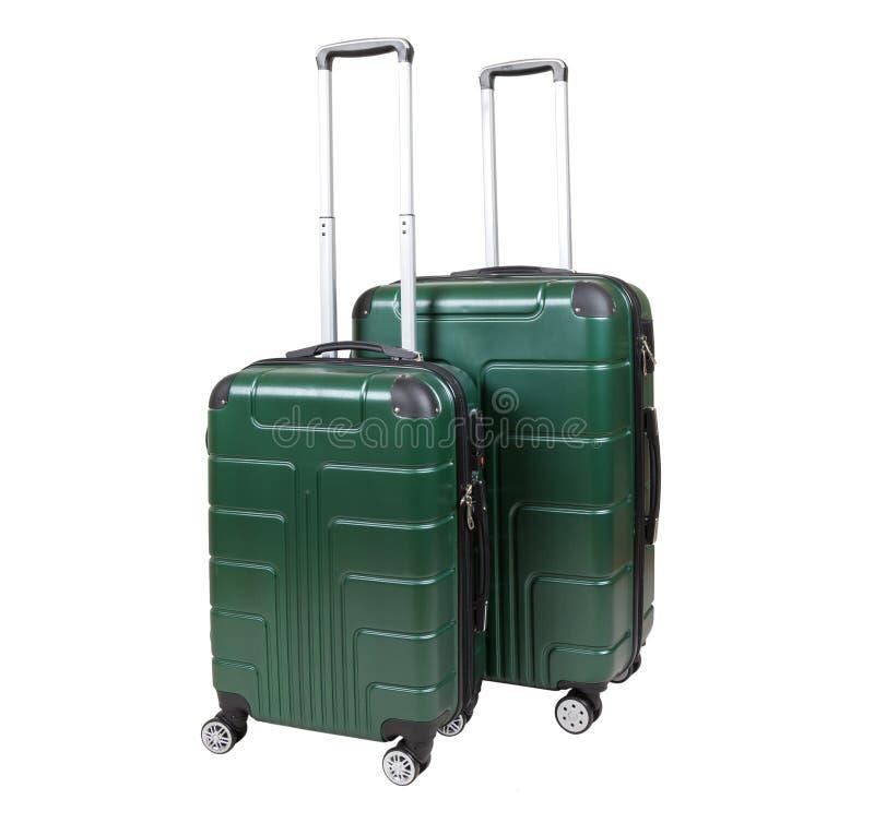 Green suitcase isolated on white background. stock photo