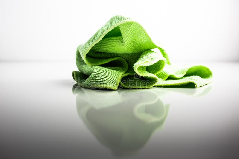 Green tablecloth isolated on white background. Keeping the house tidy stock photos