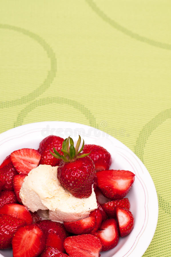 Green Tablecloth With Red Strawberries Royalty Free Stock Images