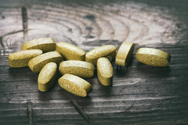 Green tablets. dietary supplements royalty free stock image