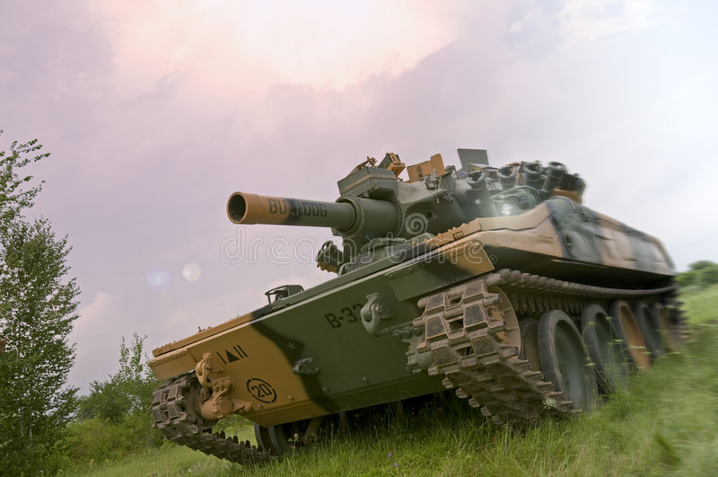 Green Tank in Purple Haze. An American M551 Sheridan light tank, armed with the MGM-51 Shillelagh gun-launched missile system, going on the offensive in Vietnam stock images