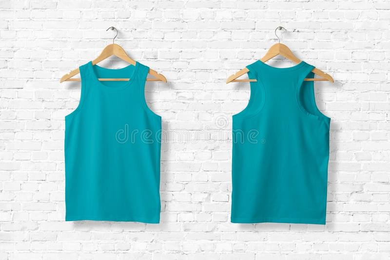 Green Tank Top Mock-up hanging on white wall. royalty free illustration