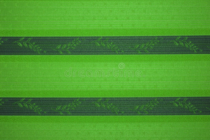 Green tapestry. Detail of a wall covered with green tapestry royalty free stock photos