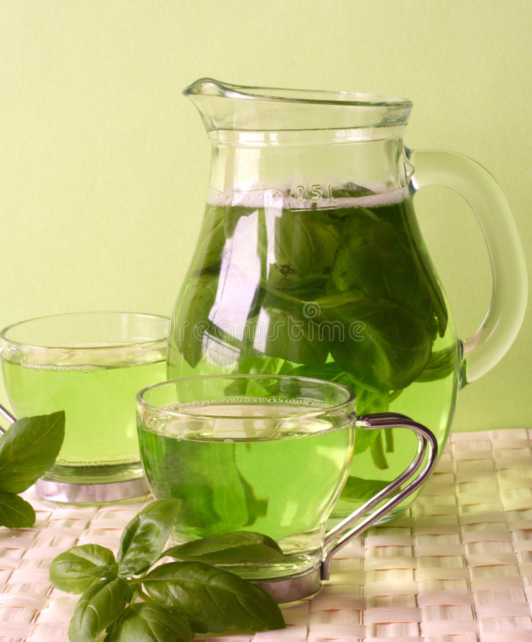 Green tea. With herbs, close-up stock photo
