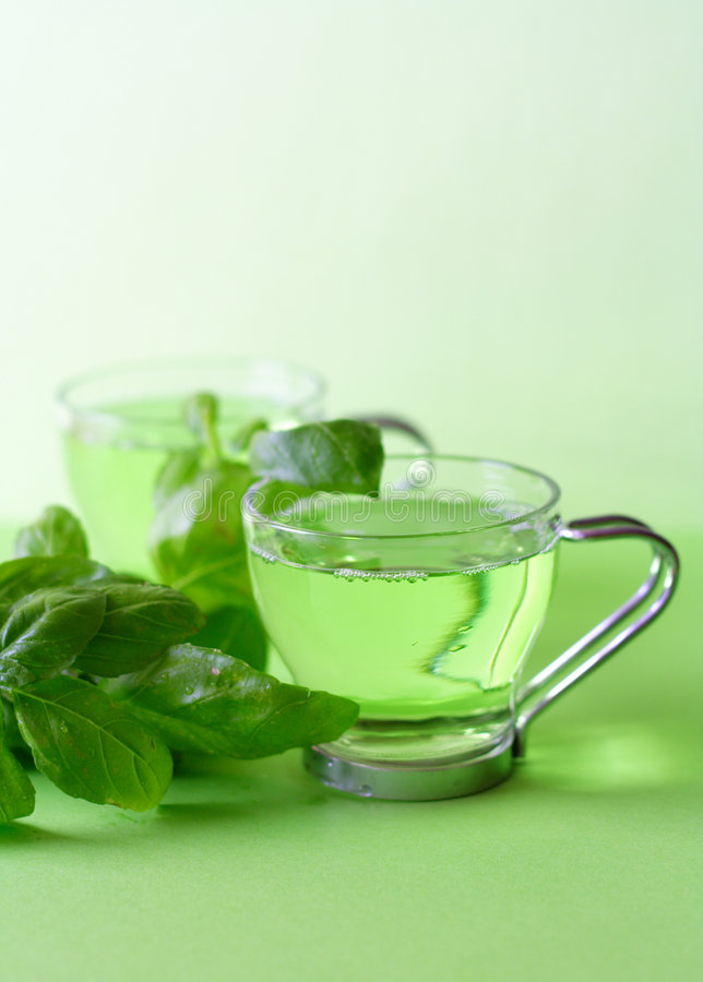 Green tea. With herbs, close-up stock image