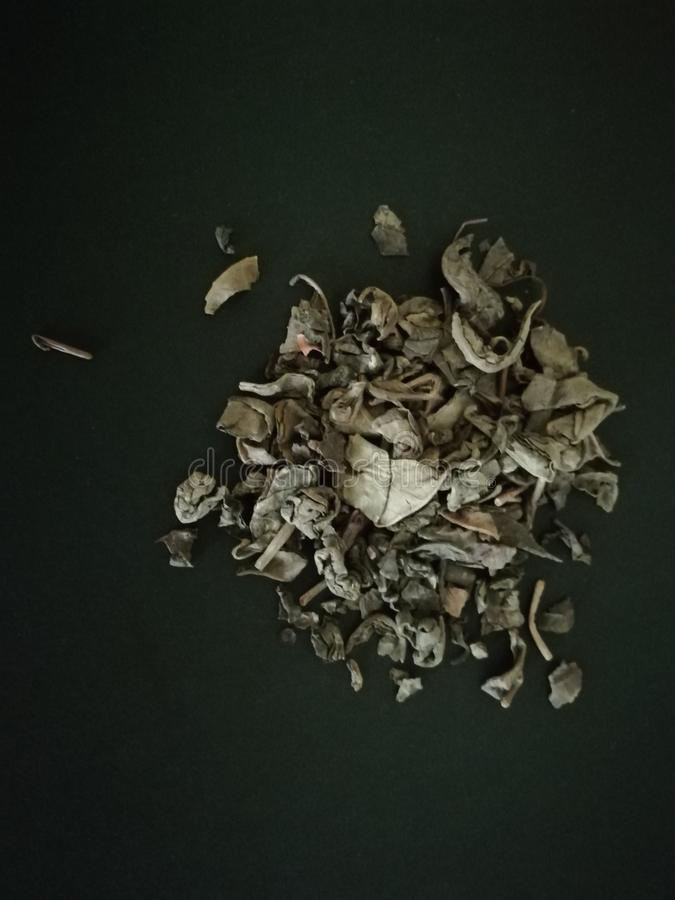 Green tea in black background . Copy space royalty free stock images