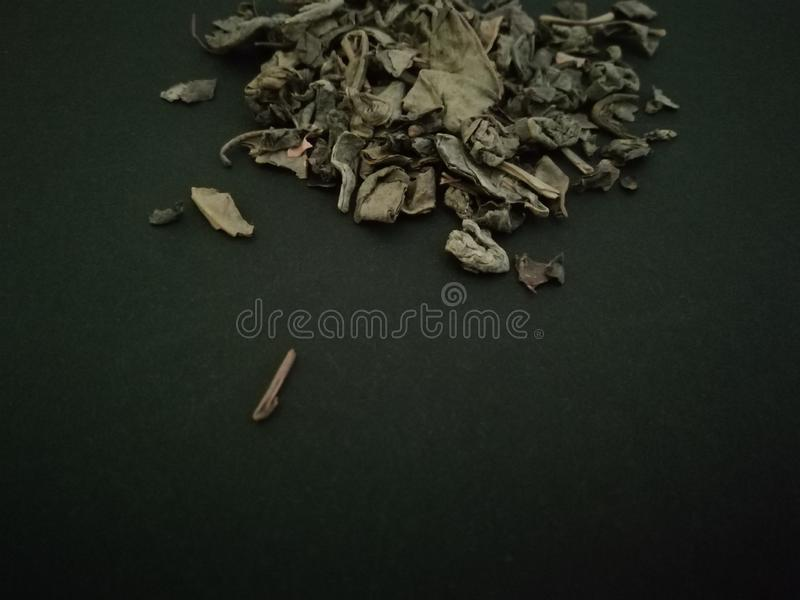 Green tea in black background . Copy space stock photo