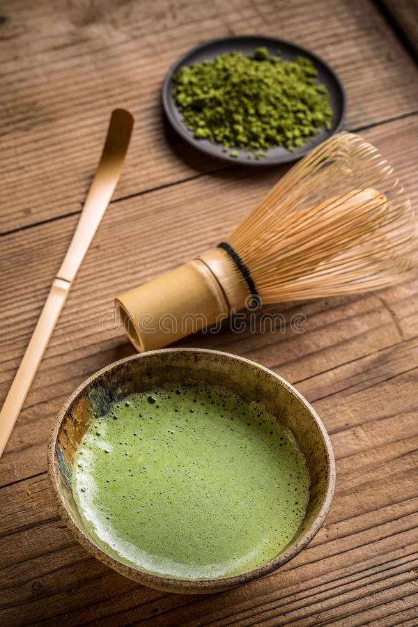 Green tea in bowl royalty free stock photo