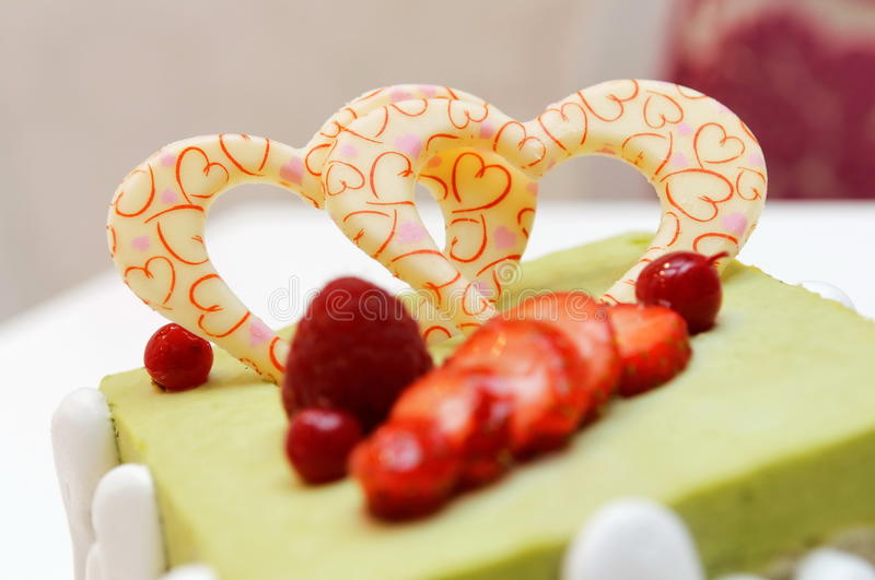 Green tea cake. With heart shape sugar icing royalty free stock image