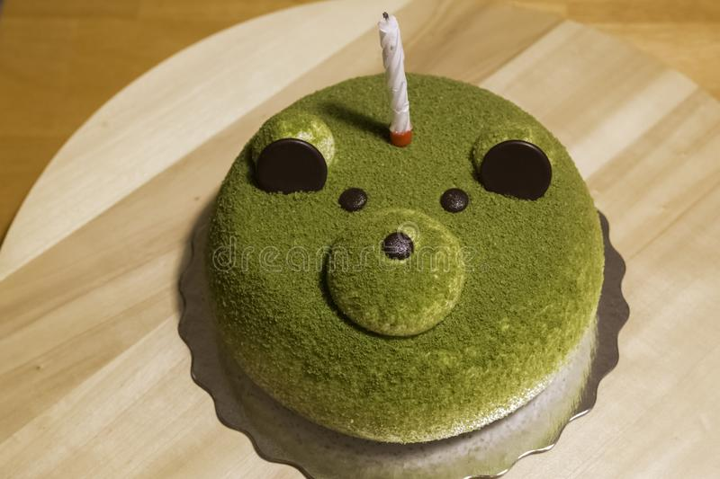 Green Tea Cake with Candle stock photo