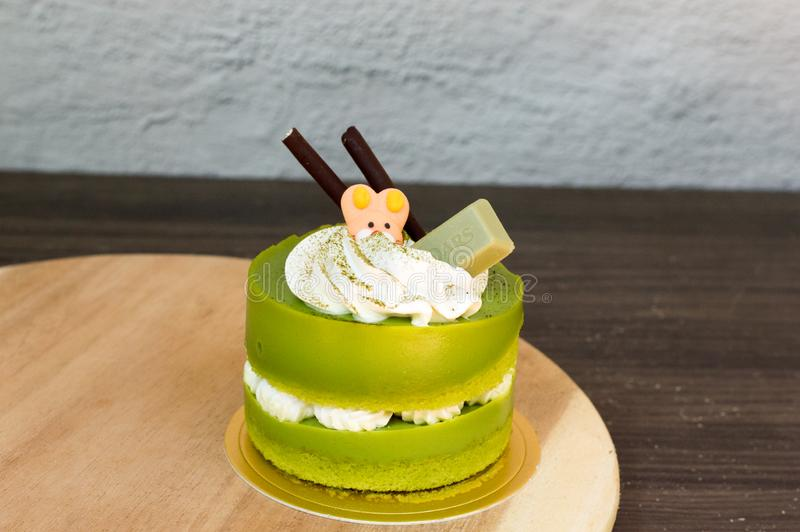Green tea cake placed on a wooden plate stock images