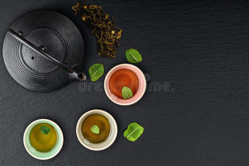 Green tea in cast-iron teapot royalty free stock images