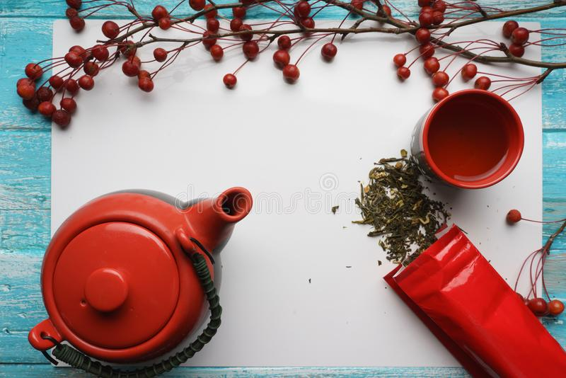 Green tea, close-up, top view Dry leaves, teapot, a Cup of tea, and red packing bag on white background vector illustration