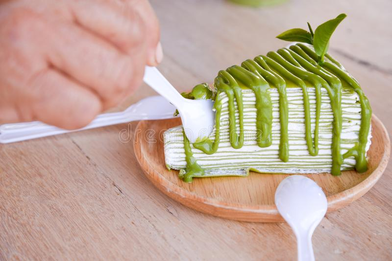 Green Tea Crepe Cake. Crepe cake flavored green tea on a wooden plate royalty free stock photos