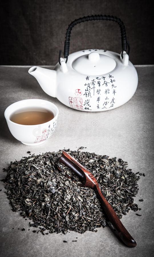 Green tea, cup and kettle for chinese tea ceremony royalty free stock photos
