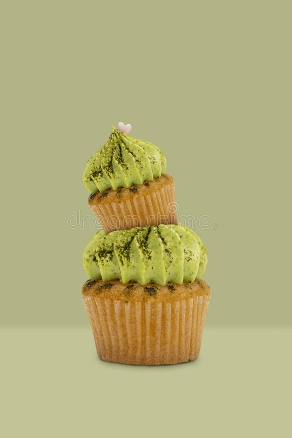 Green tea cupcake on green background, idea minimal concept for new year and christmas holliday.  royalty free stock images