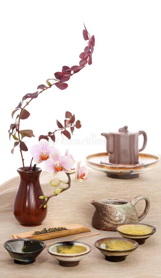 Green tea and flowers stock photos