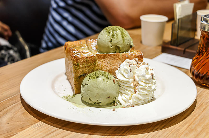 Green tea ice cream honey toast with wihp cream stock photography