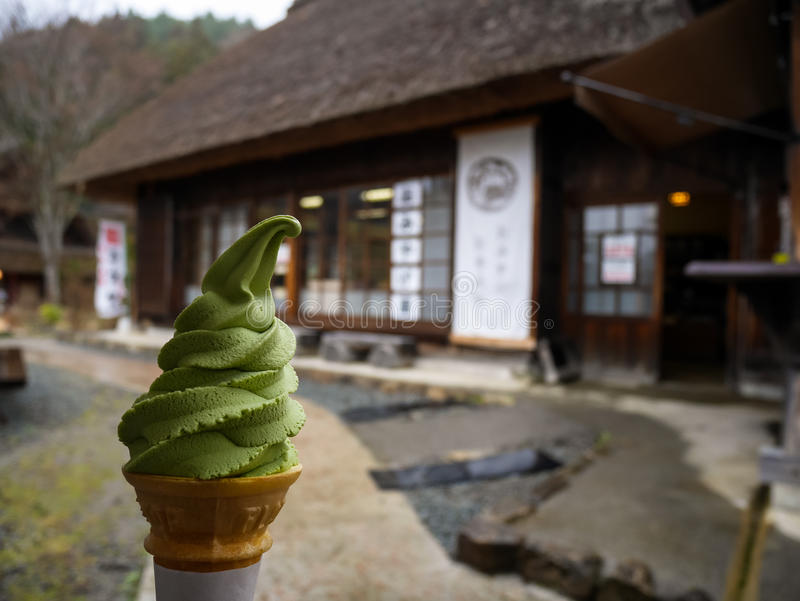 Green tea ice cream soft serve cone with traditional japanese ho stock image