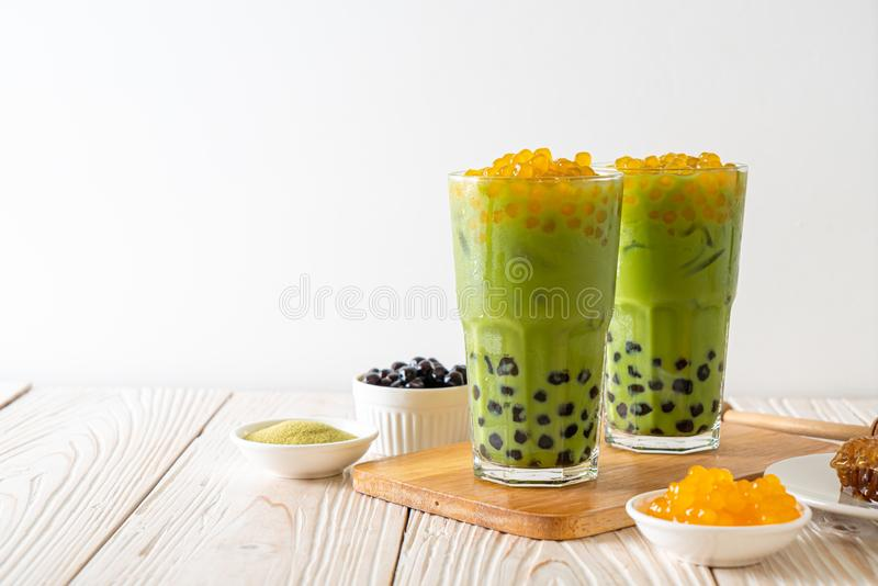 green tea latte with bubble and honey bubbles royalty free stock image