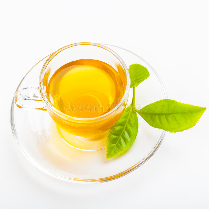 Green tea leaf and glass cup of black tea stock photo