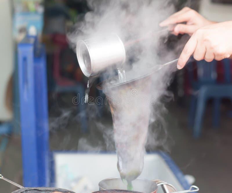 Green tea making, antique formula , motion blurred stock photos