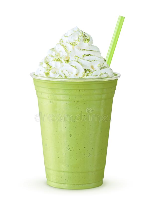 Green Tea Matcha Frappe with Whipped Cream. A green tea frappe, smoothie, or milkshake with whipped cream and a straw. This blended drink is made with Japanese royalty free stock photos